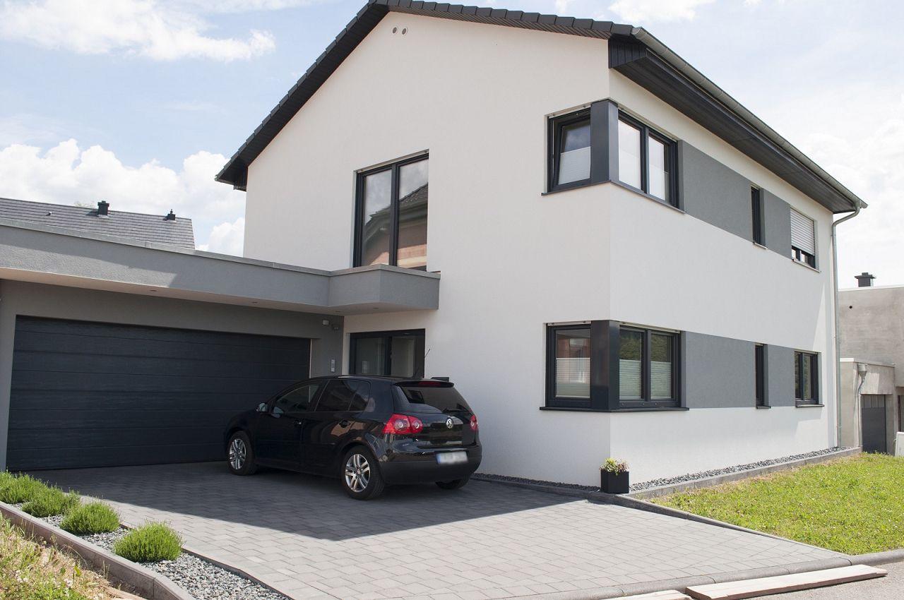 Garage und carport direkt mit dem fertigh user bauen for Haus mit doppelgarage bauen